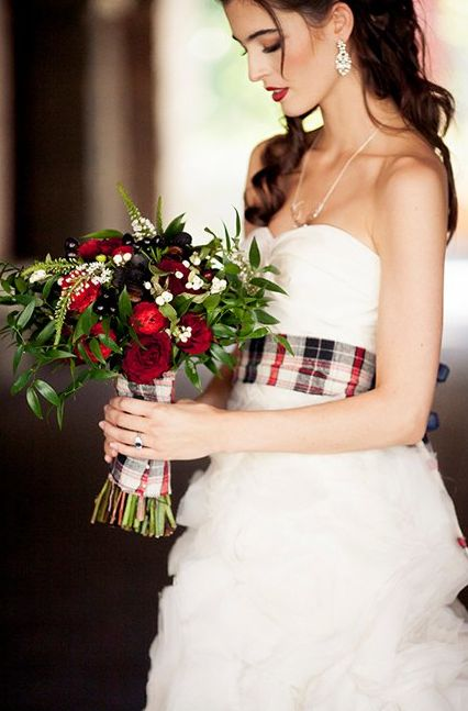 a plaid bouquet wrap that matches the bridal sash is a great idea for a Scottish wedding