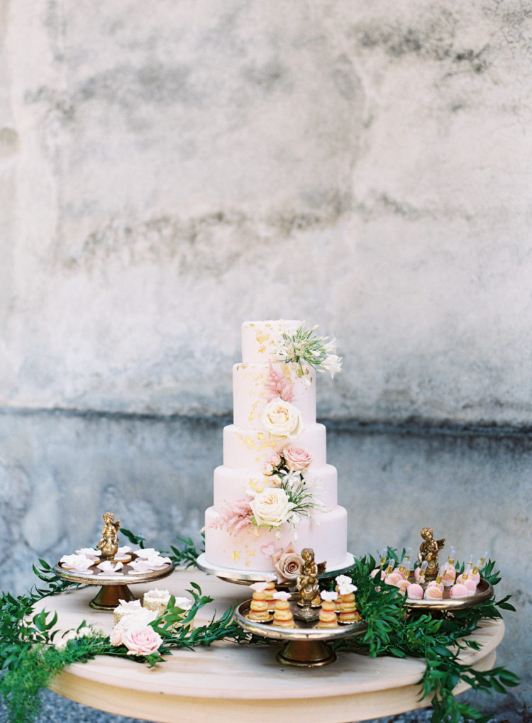 The dessert table was decorated with greenery and the cake was a watercolor one with fresh blooms, there were many other desserts too