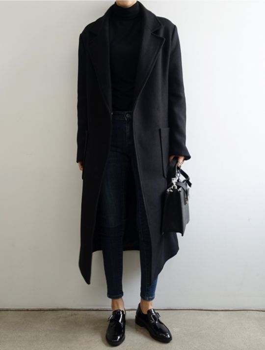 blue jeans, a black turtleneck, a black coat and polished shoes can be worn to the office
