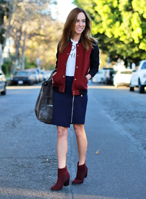 With white t-shirt, navy blue skirt, marsala boots and black bag