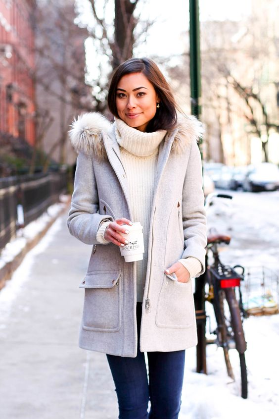 a grey winter coat with a faux fur hood, pockets and a zip is a comfy option