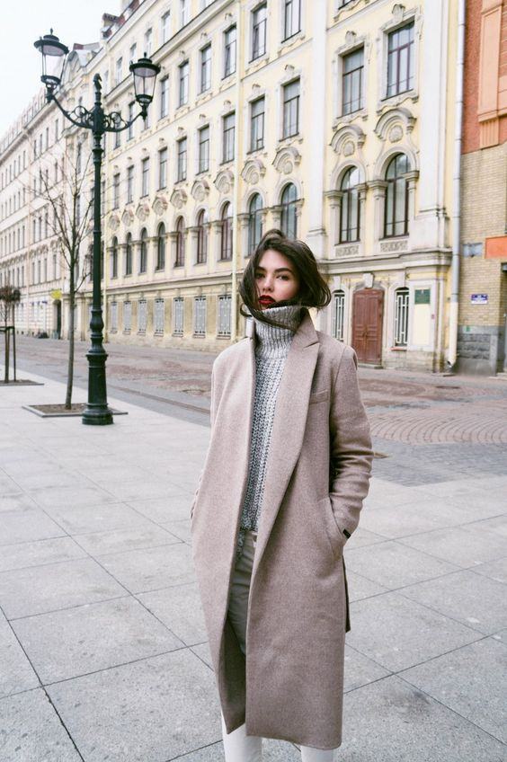 white jeans, a grey turtleneck sweater, a blush coat for a cozy winter look