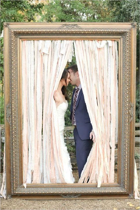 a large vintage frame with ribbons for a creative photo booth