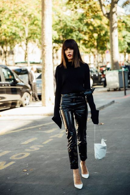 With black turtleneck, white shoes and white bag