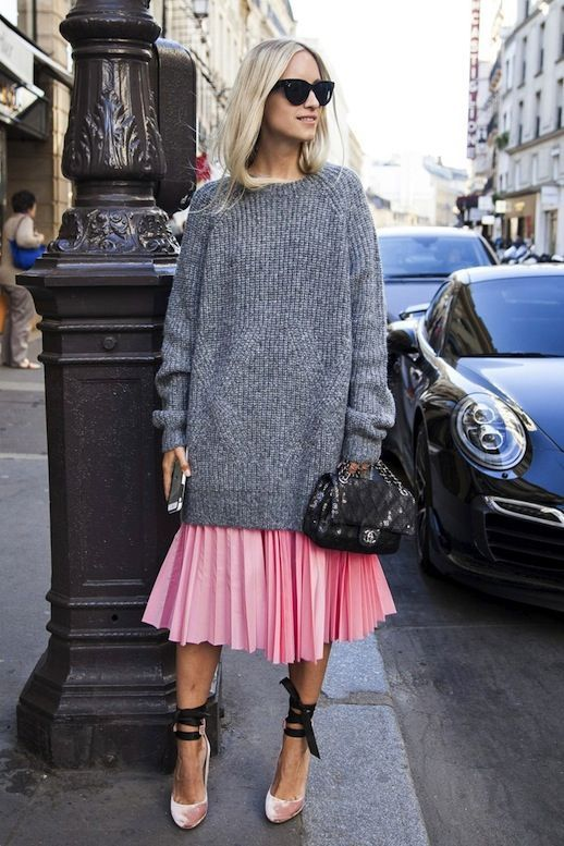 a long grey chunky knit sweater, a pink pleated skirt, a blush velvet pair of shoes