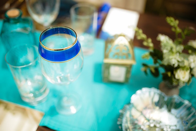 Blue and gold rimmed glassware