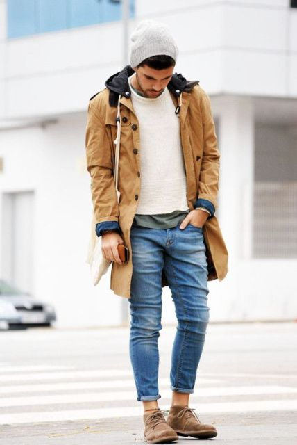 With white sweater, suede boots and brown parka