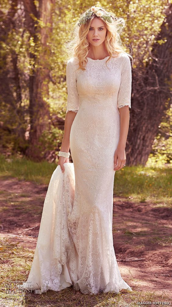 a modest lace wedding dress with half sleeves and a long train
