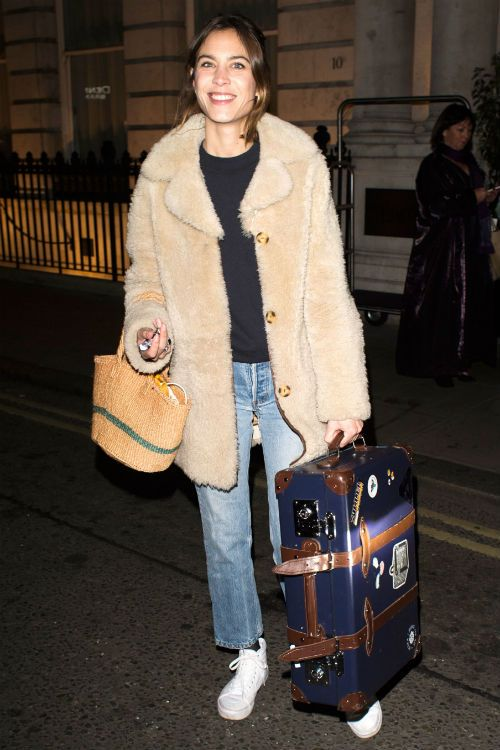 cropped jeans, a black top, a fuzzy coat, white sneakers for comfort and to look trendy