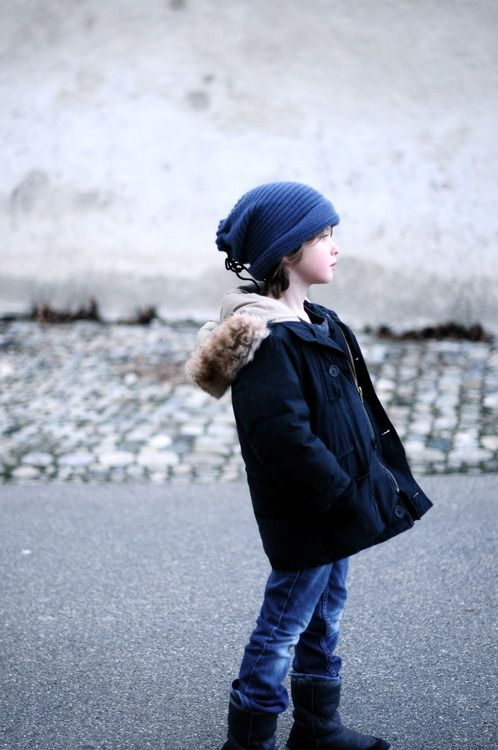 a navy parka with faux fur, denim and navy ugg boots