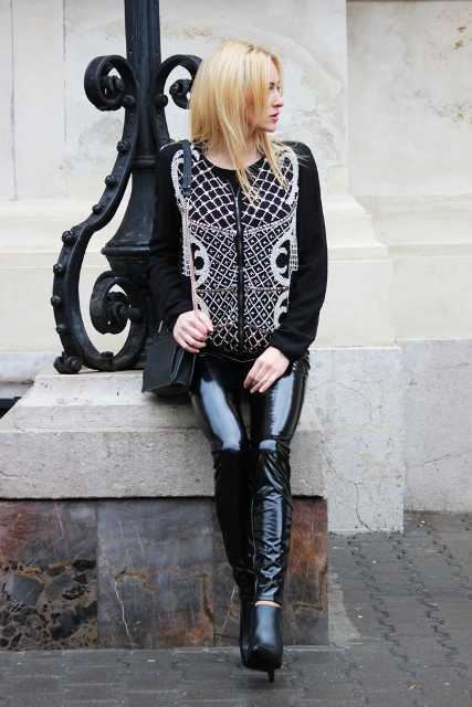 With printed sweater, black ankle boots and black bag