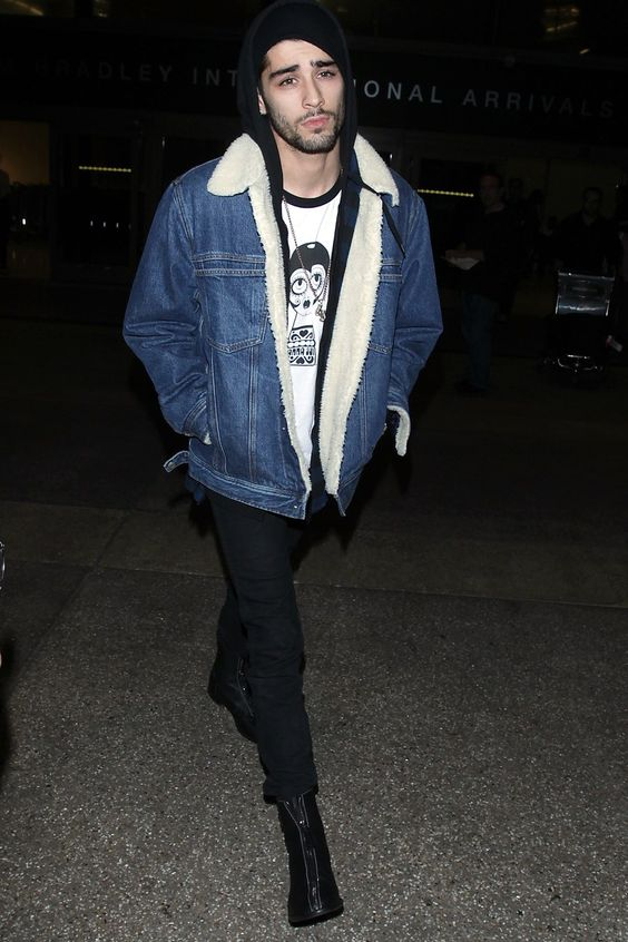 black jeans, a printed tee, a hoodie, a denim shearling coat and boots