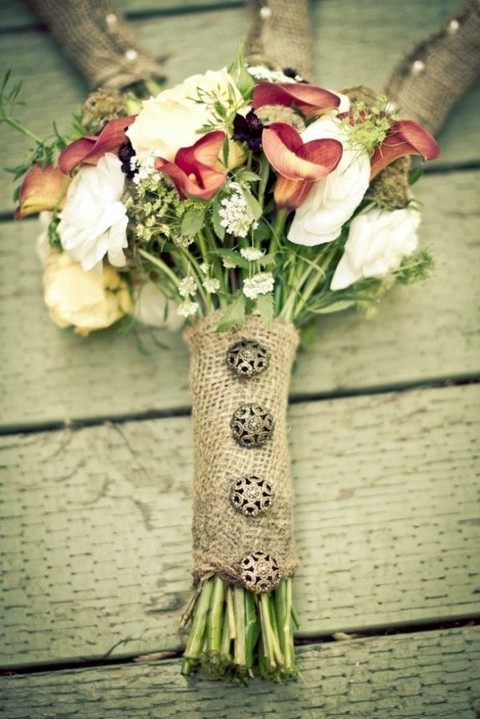 burlap wrap with vintage buttons looks rustic and very chic and will match many flowers