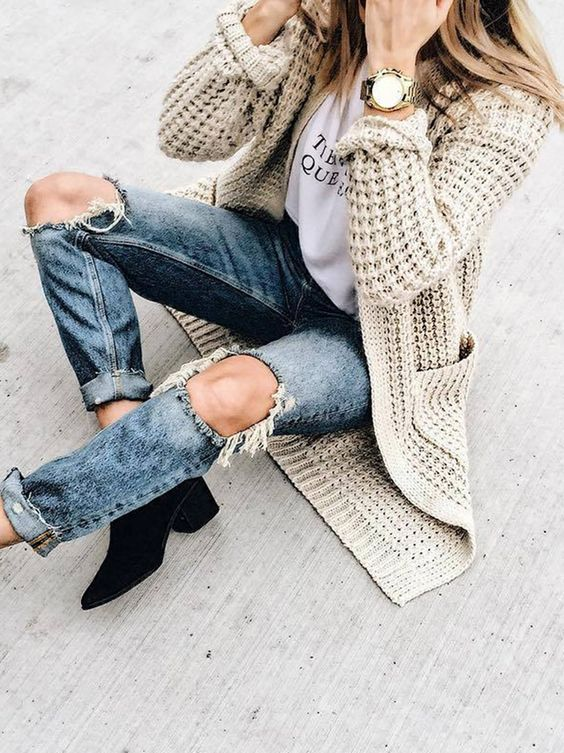 ripped denim, black suede booties and a neutral chunky knit cardigan
