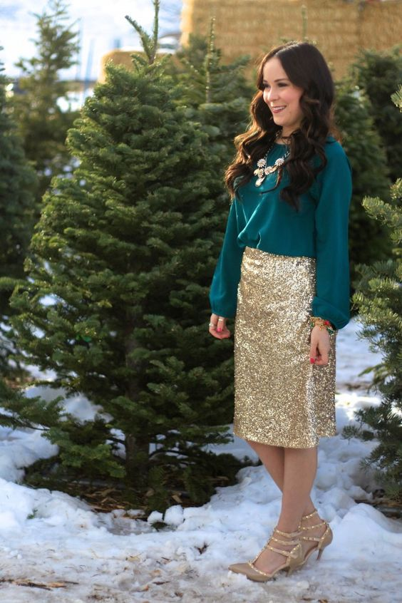 an emerald shirt, a statement gold necklace, a gold sequin skirt and nude Valentino shoes