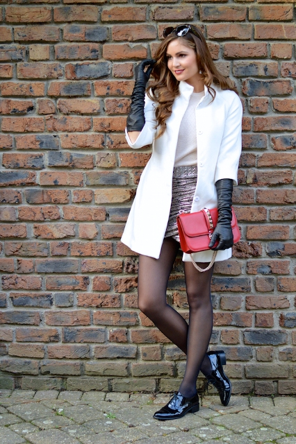 With white shirt, wrap skirt, white coat, red clutch and flat shoes
