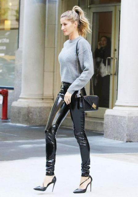 With gray crop sweater, black pumps and mini bag