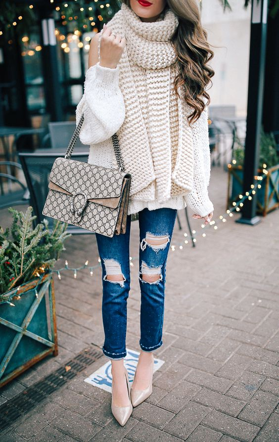 a creamy off the shoulder sweater, a scarf of the same shade, ripped denim, nude shoes and a bag