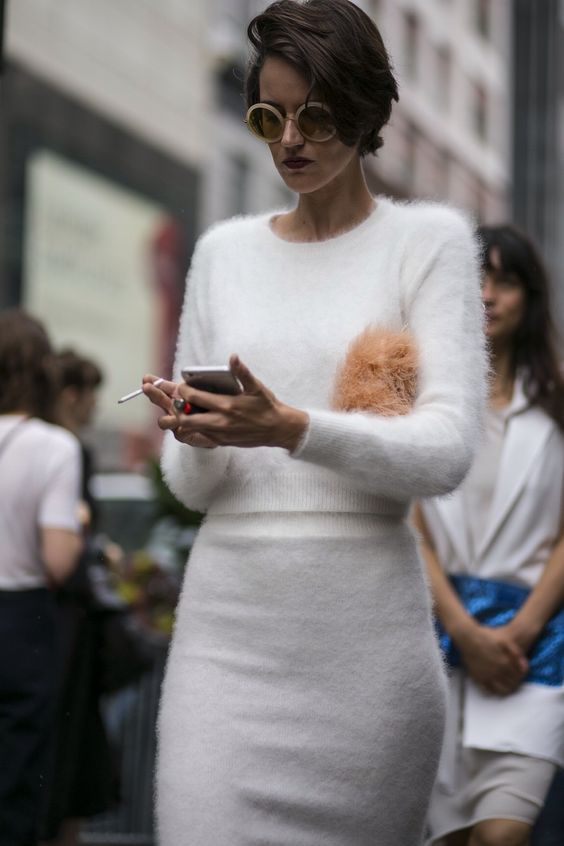 a white angora duo of a long sleeve top and a pencil skirt for a modern clean look