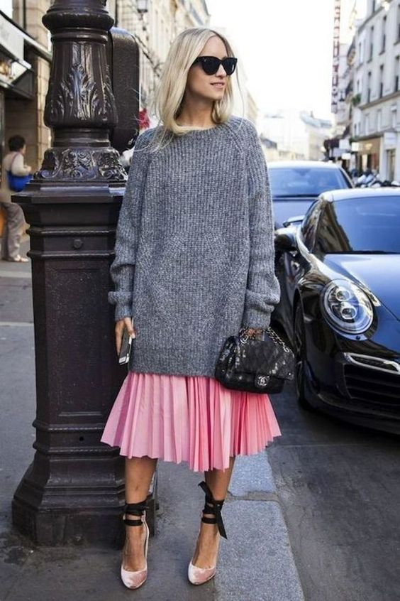 a pink pleated midi skirt, a grey oversized sweater, pink velvet shoes with lacing up
