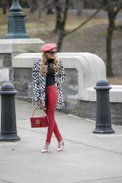 With printed coat, black turtleneck, red pants and beige pumps