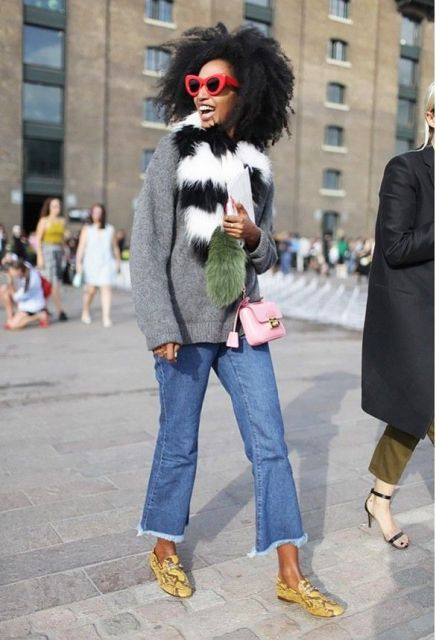 With gray sweater, fur collar, pink mini bag and printed shoes