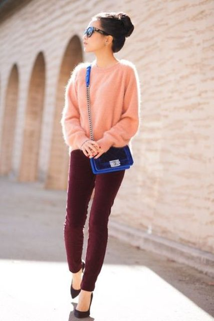 burgundy velvet pants and a peach-colored angora sweater, black heels and an electric blue bag