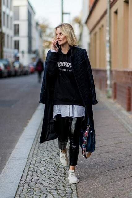 With long shirt, sweatshirt, white sneakers, navy blue coat and bag