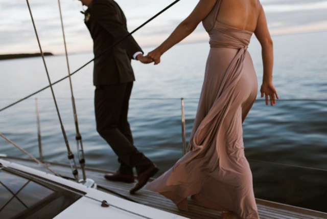 Have fun on a sailboat together like this couple