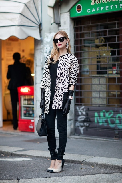 With black shirt, black pants, two color shoes, printed coat and bag
