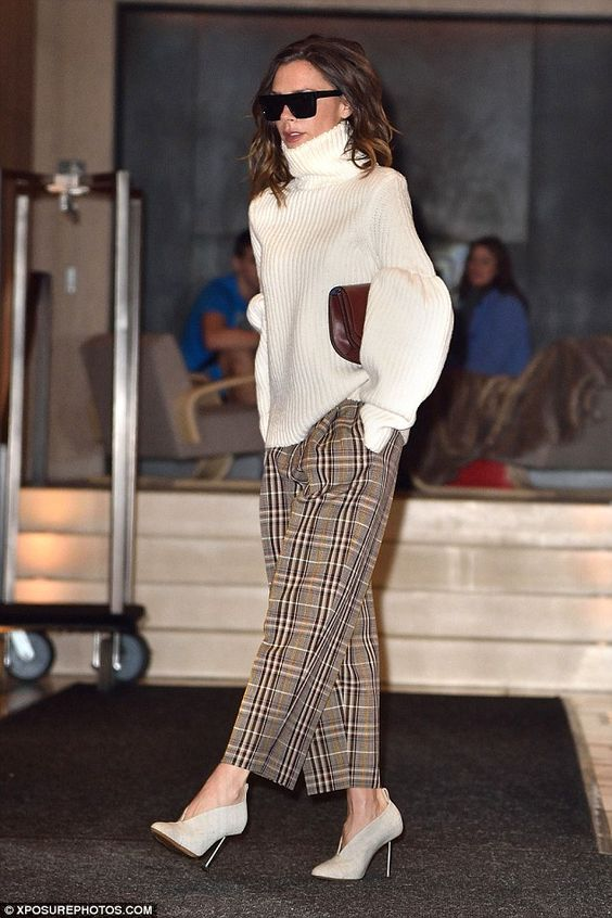 a white oversized sweater with a turtleneck, checked pants and creamy booties