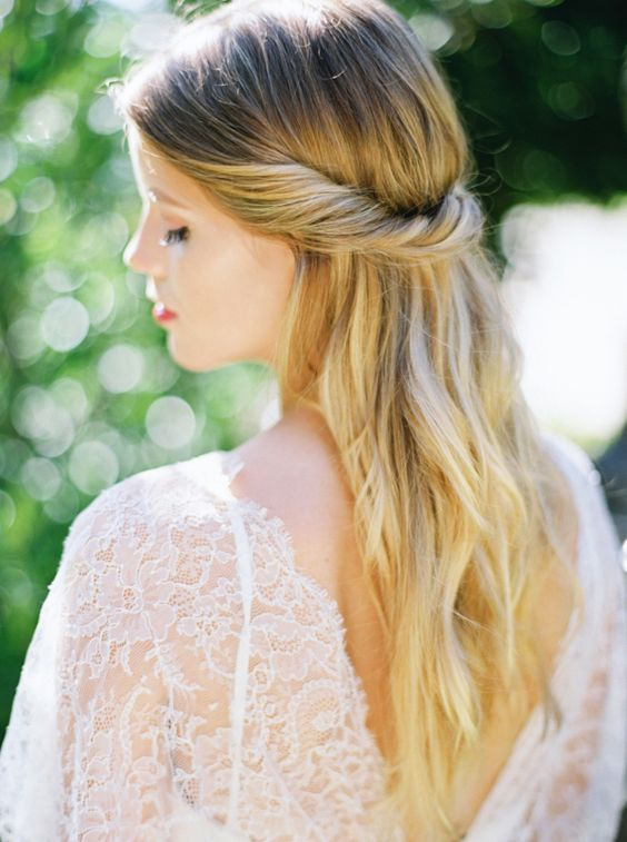 a casual twisted half updo is a timeless solution for any romantic bride