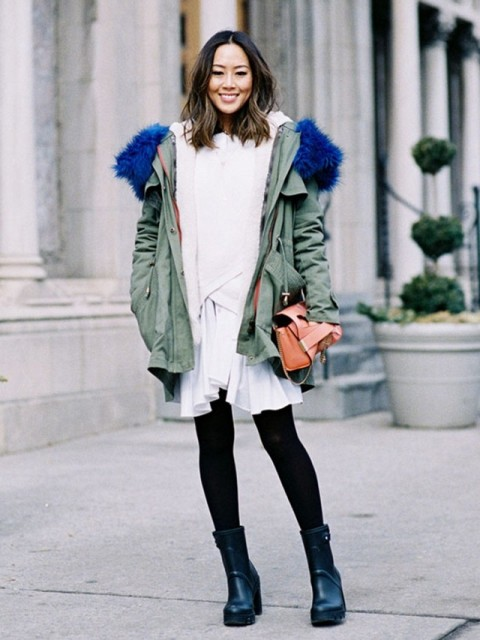 With white dress, black tights, mid calf boots and mini bag