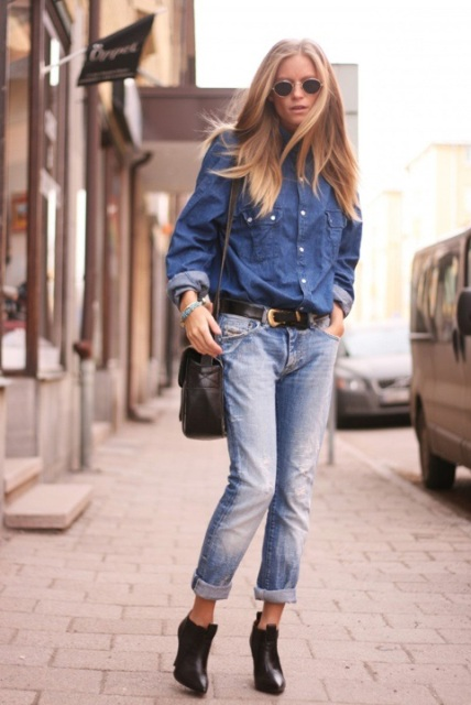 With denim shirt, black bag and ankle boots
