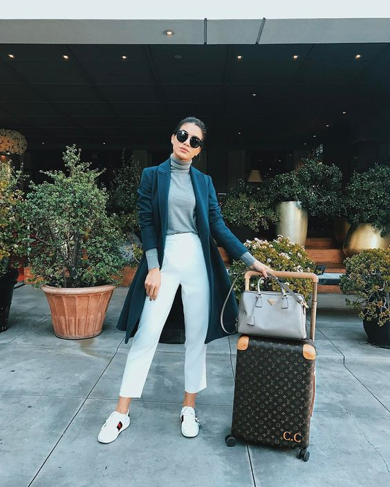 white cropped jeans, a grey top, a navy coat and white sneakers