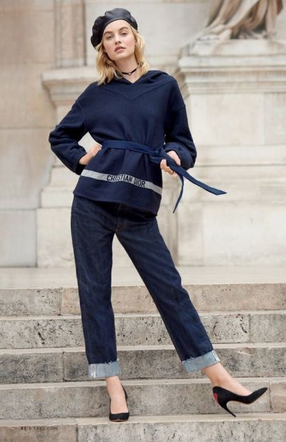 With navy blue shirt, cuffed jeans and black pumps
