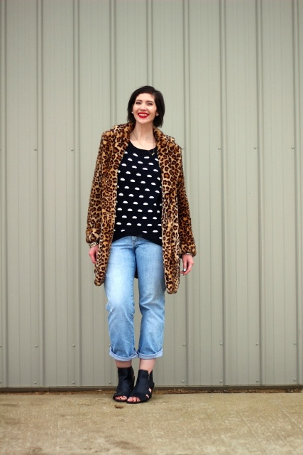 With printed sweater, leopard printed coat and cutout boots