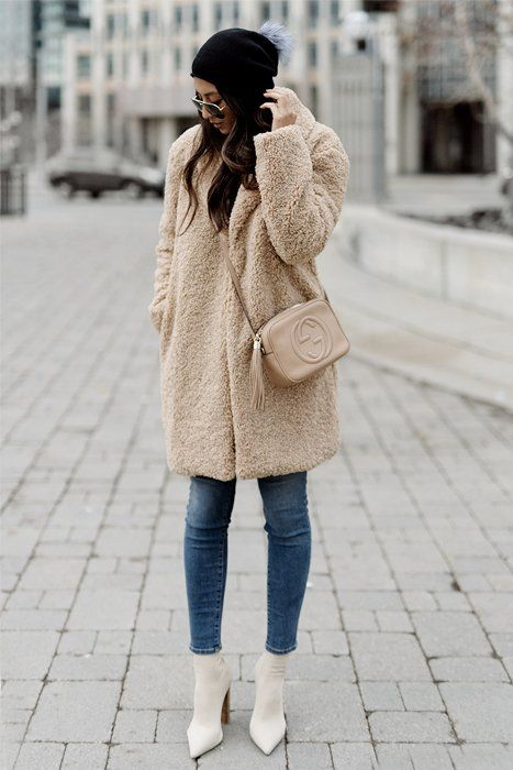 cropped jeans, a faux fur fuzzy coat, creamy sock boots and a beanie