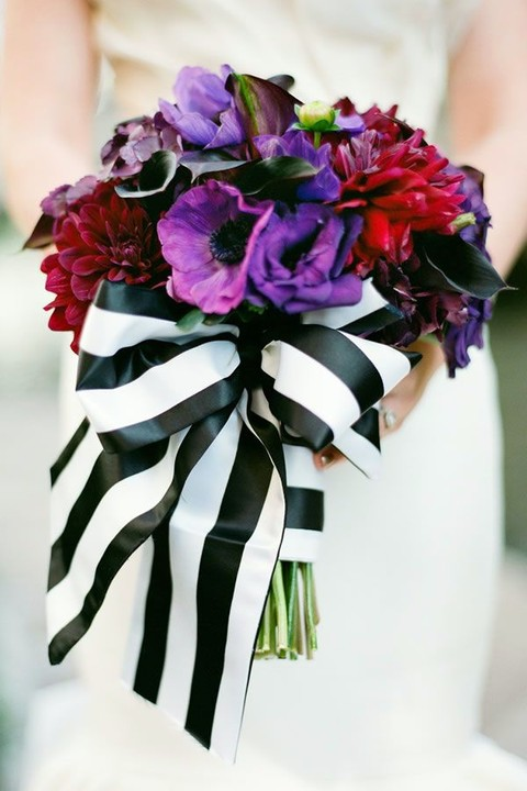 striped black and white ribbon with a large bow to make the bouquet stand out