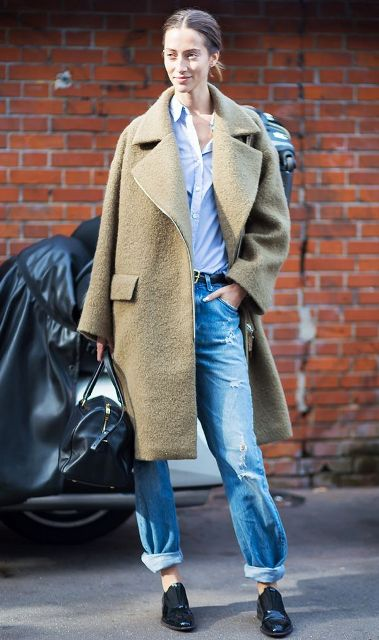With white button down shirt, black shoes, black bag and oversized coat