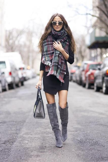 With black dress, gray suede boots and gray bag