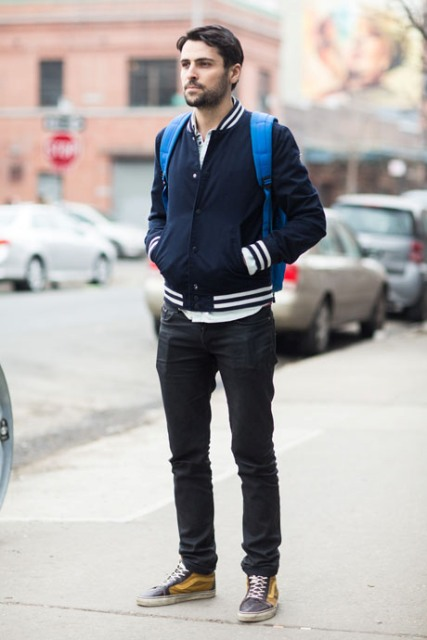 With white shirt, straight pants, blue backpack and two color sneakers