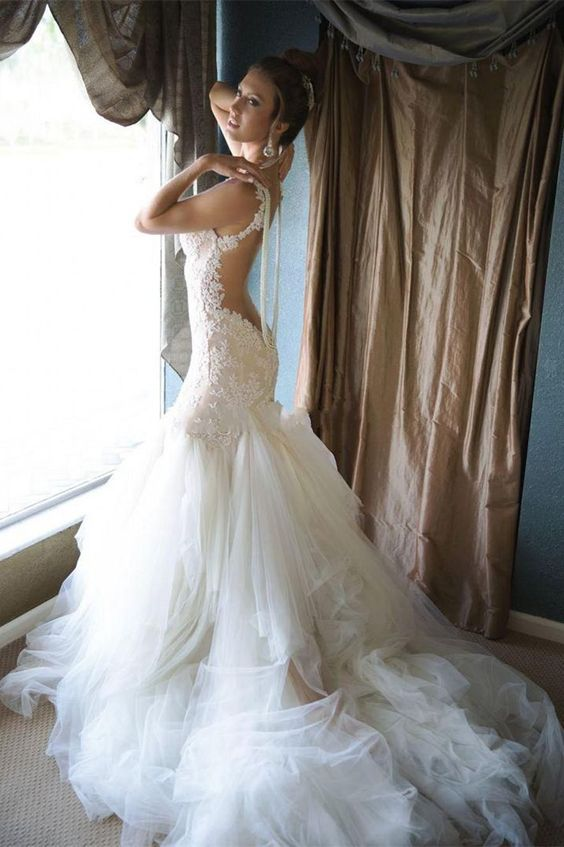 mermaid wedding dress without sleeves, with an open back and a layered skirt with a long train