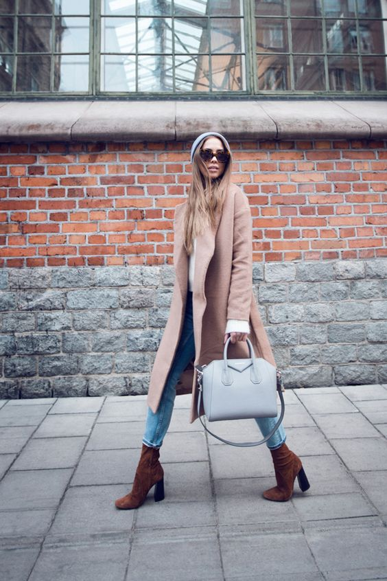 a blush coat, a white shirt, blue cropped jeans and brown suede boots