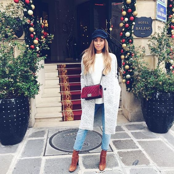 blue cropped jeans, a white sweater, a grey coat and brown sock boots