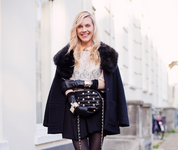 With lace shirt, mini skirt and fur coat