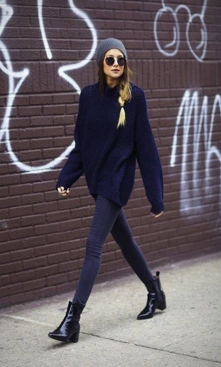 dark denim, an oversized navy sweater, a grey beanie and black chelsea boots