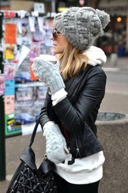 a grey textural pompom beanie and matching gloves, the pompom of yarn