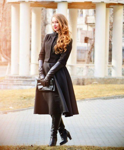 With midi skirt, jacket, clutch and high boots