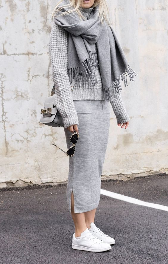 a grey midi skirt, a grey sweater, a grey scarf, white sneakers and a grey bag for a comfy look